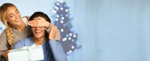 image of holiday couple covering lasik eyes